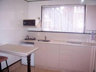 Econo Lodge Alcala Motel Dunedin Dunedin - Suite Room