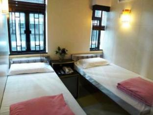 New International Guest House Hong Kong - Quartos
