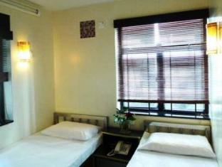 New International Guest House Hong Kong - Gastenkamer