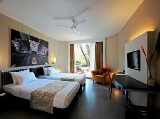 Whispering Palms Beach Resort Goa - Chambre