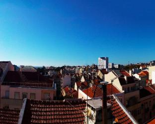 A room in a home with a view over Lisbon
