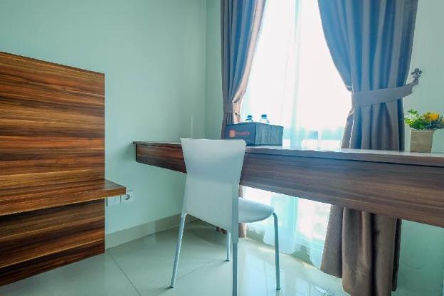Homey Studio Apt @ Grand Dhika City By Travelio