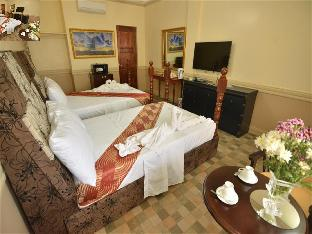 Фото отеля Inn and Suites at Roz and Angeliques