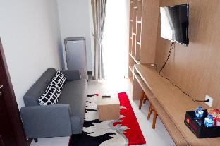 Cozy 1BR Scientia Residence Apartment By Travelio Tangerang