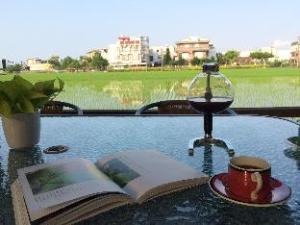 Om Peaceful Coffee Bed & Breakfast (Peaceful Coffee Bed and Breakfast)