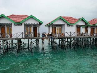 Фото отеля Sari Cottage Derawan