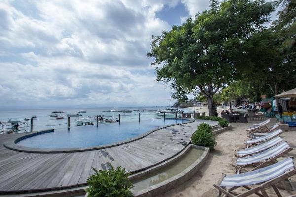 Deluxe Garden beach front Infinity public pool  Bali
