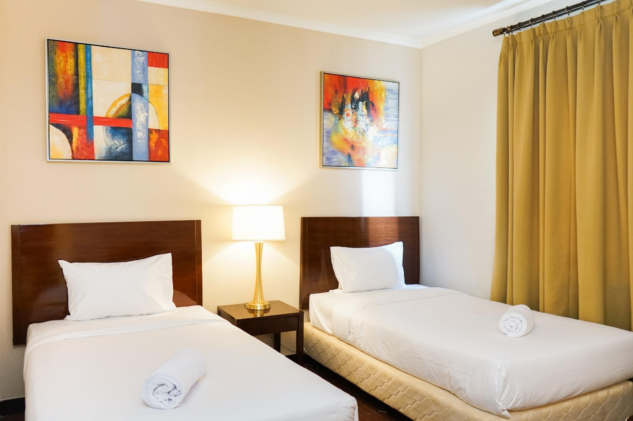 Cozy Ancol Marina 1BR Twin Bed Tower A By Travelio