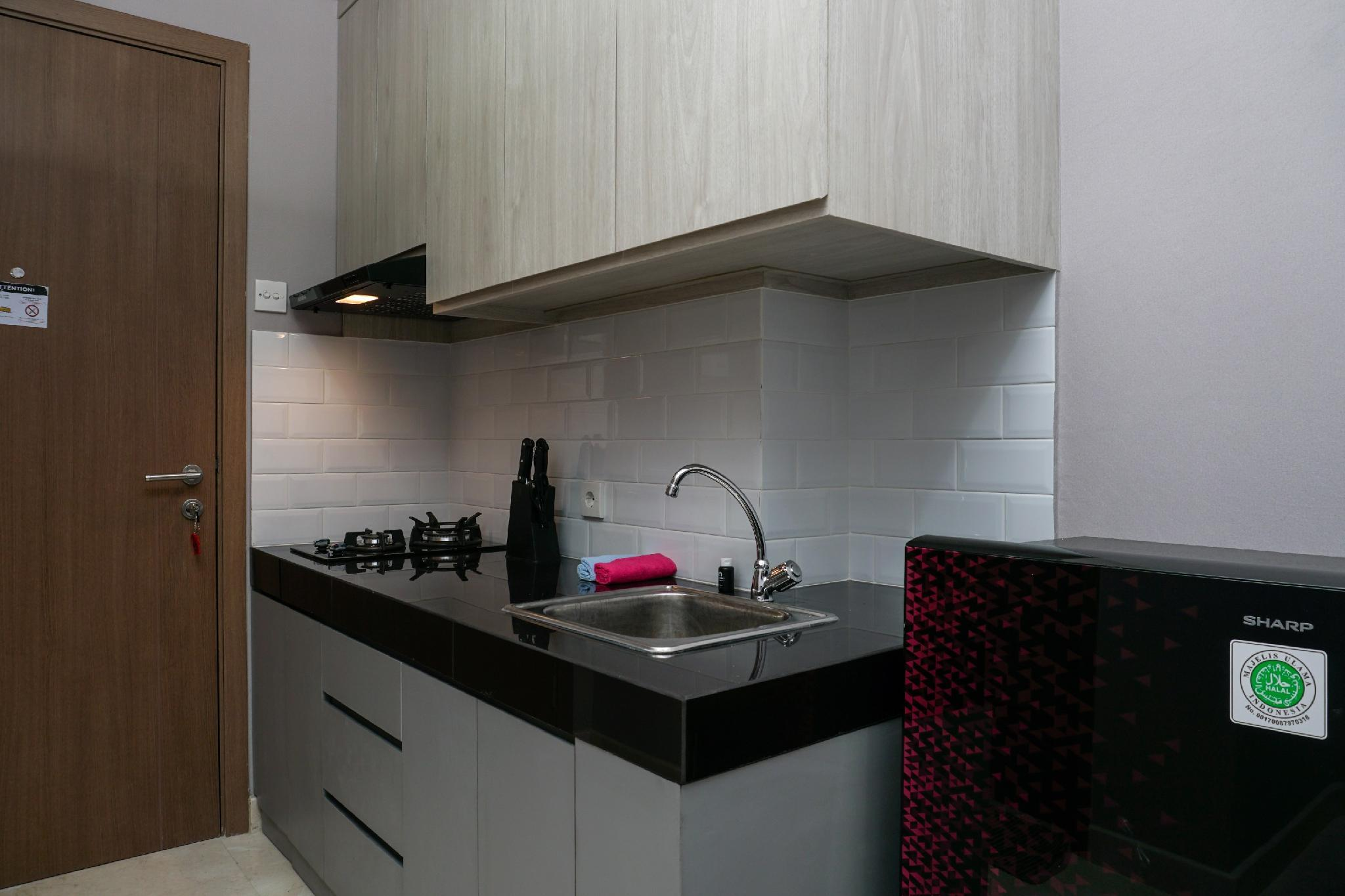 Cozy 1BR At Puri Orchard Apartment By Travelio