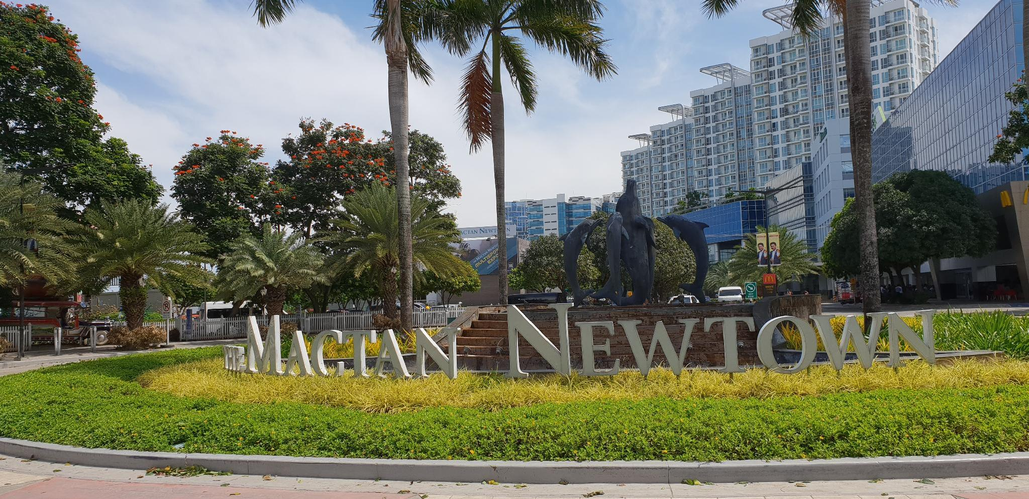 Mactan Newtown With Green Trees And Sea View